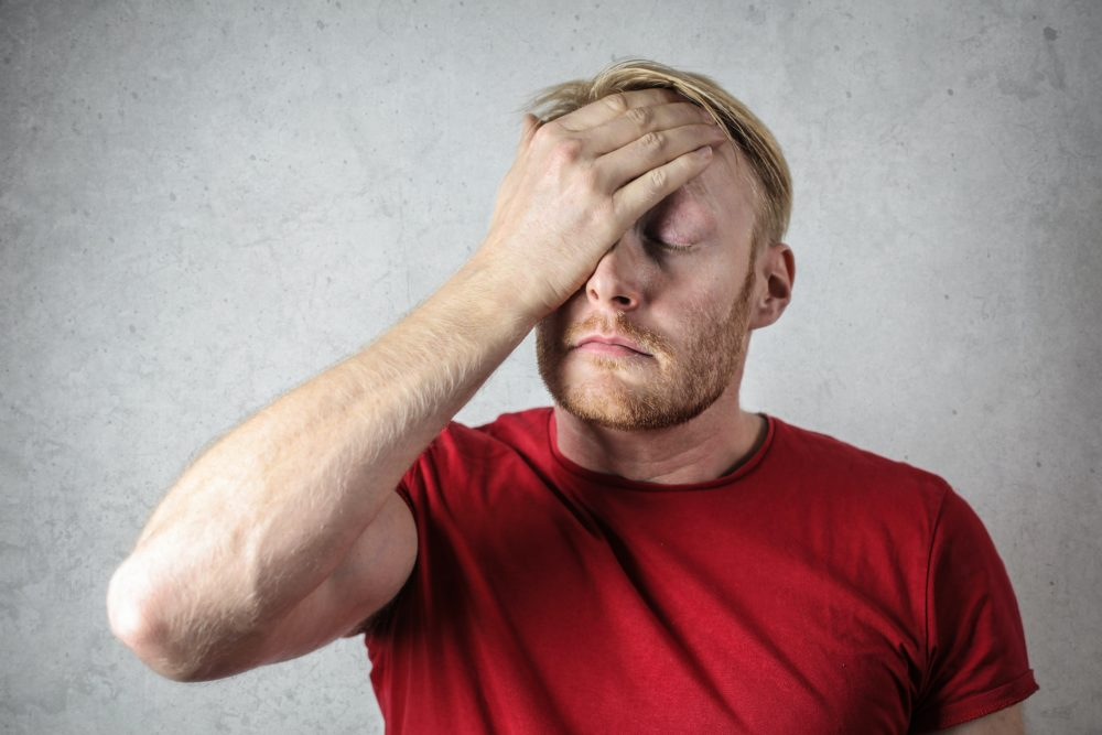 man holding his head due to confusion around property values