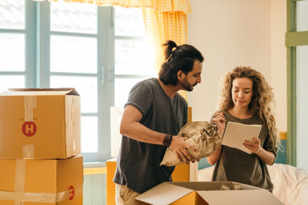 Couple moving into or out of a home