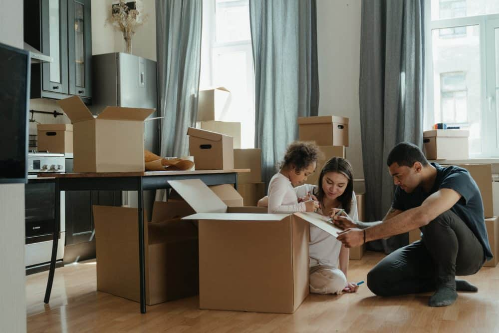 Family opening boxes in new home