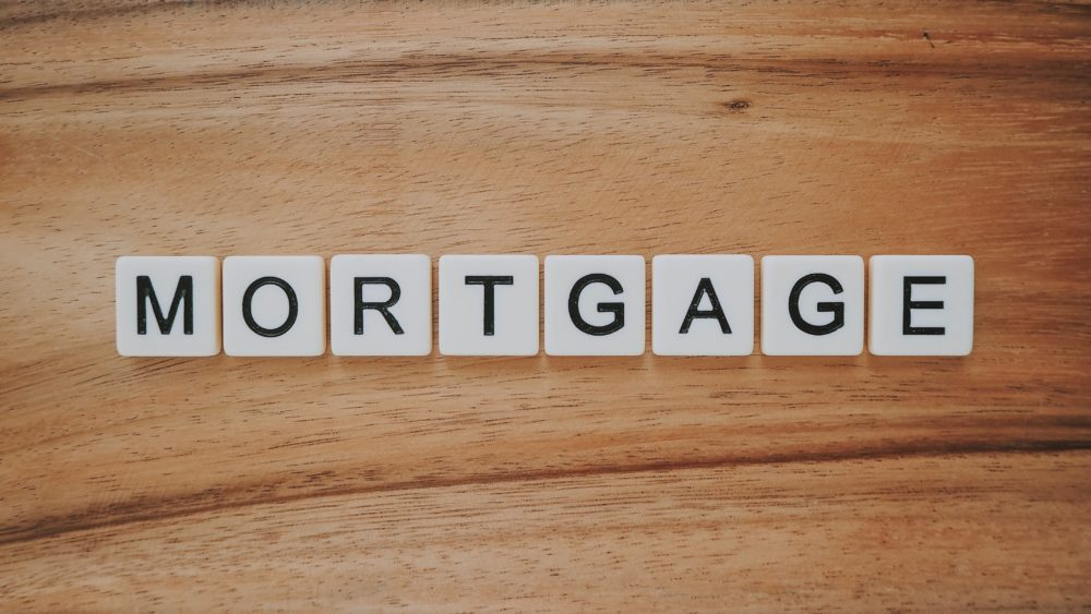 The word mortgage spelt out on a wooden background