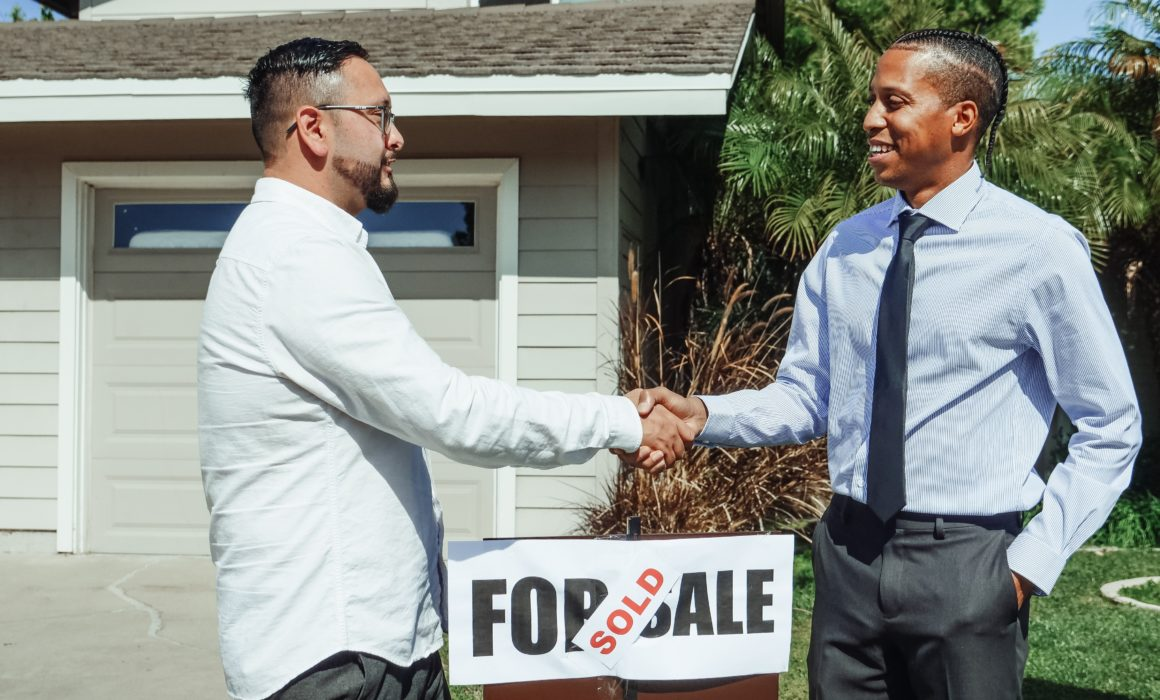 Two men shaking hands following a mortgage deal