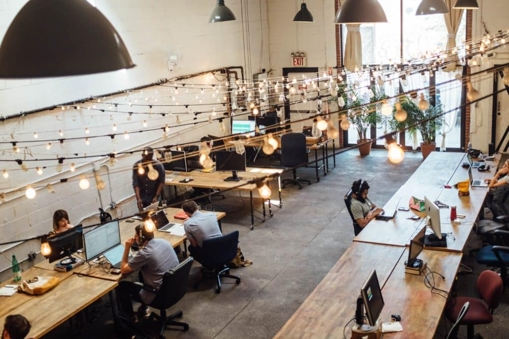 A group of workers in a shared office space